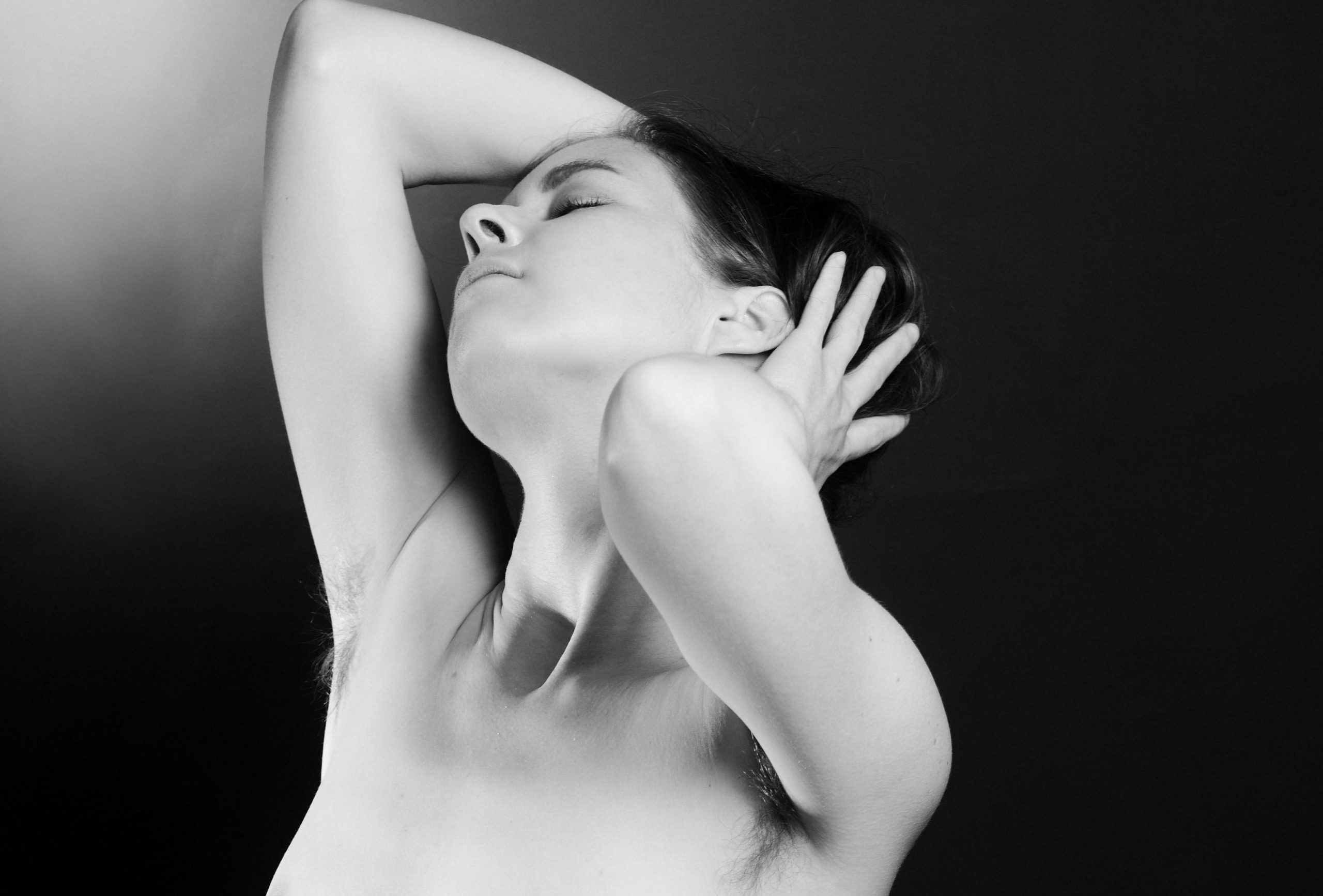 Girl showing hairy armpits